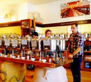Nate Bradley assisting a customer at Amphora Nueva's tasting bar of the newest olive oils
